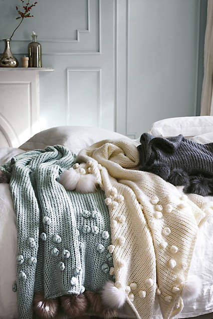 Cozy throw with pom pom